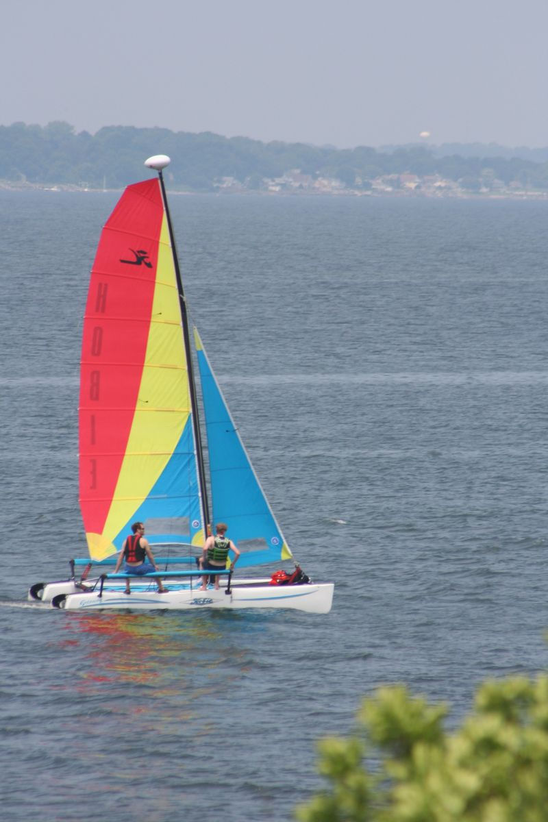 red yellow blue sailboat