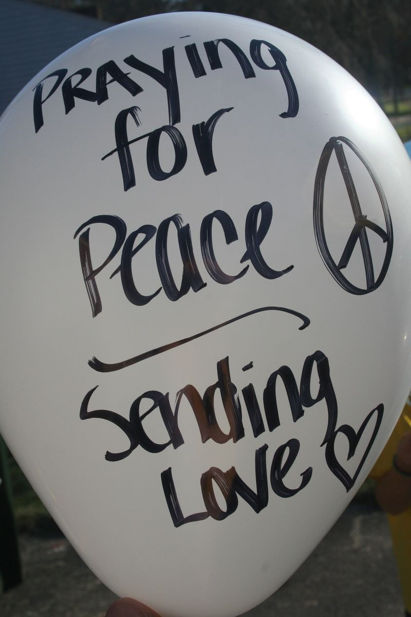 Praying for peace sending love balloon